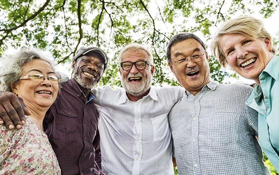 Older group of people celebrating their medicare supplement enrollment